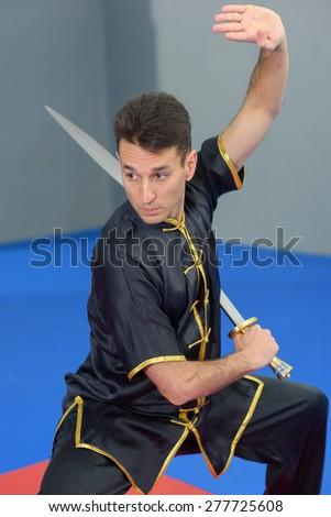 Martial arts expert using a sword - stock photo