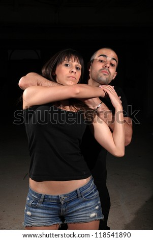 martial arts female instructor exercising with young man - stock photo
