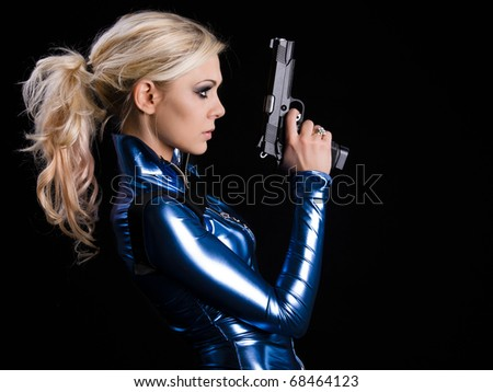martial young lady with gun - stock photo