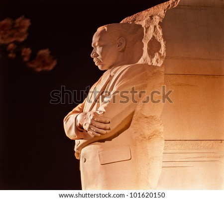 Martin Luther King Jr. Memorial Statue Cherry Blossoms Evening Washington DC Sculptor is Lei Yixin - stock photo