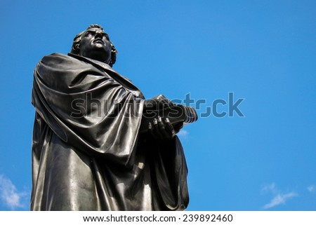 Martin Luther monument in front of Frauenkirche cathedral in Dresden, Germany - stock photo
