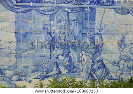Martin Moniz brave knight in the gate of the castle of St. George. Azulejos - stock photo
