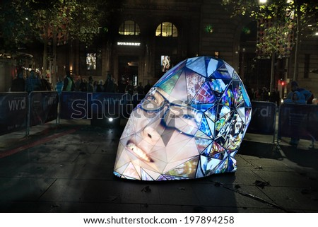 MARTIN PLACE, SYDNEY, AUSTRALIA - JUNE 6, 2014;  Locals and tourists observe and participate in  e|MERGEnce installation in Martin Place, Sydney during Vivid Sydney annual festival event.  - stock photo
