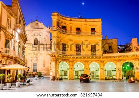 Martina Franca, Puglia in Italy. Piazza Plebiscito and Basilica di San Martino at twilight. - stock photo