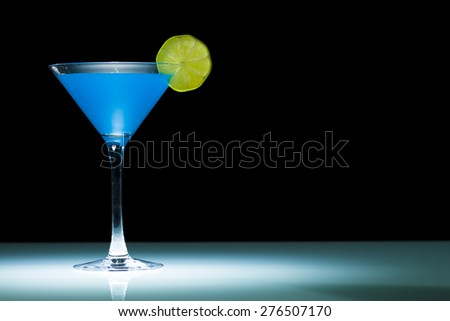 Martini cocktail with fresh lemon  - stock photo