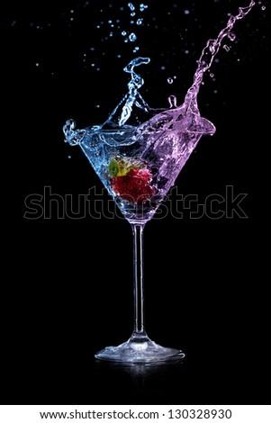 martini drink over dark background - stock photo