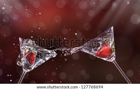 Martini drinks splashing out of glass - stock photo