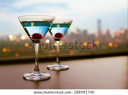 Martini drinks with a city view.  - stock photo