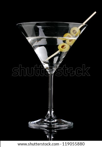 Martini glass and olives isolated on black - stock photo