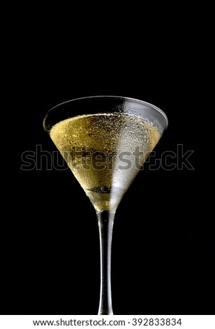 martini glass on a black background - stock photo