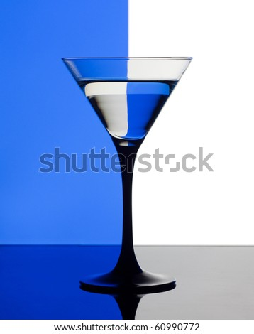 Martini glass on a blue and white background - stock photo