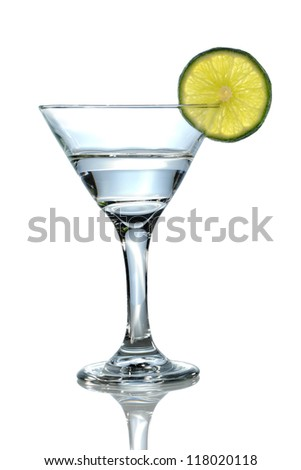 Martini glass with clear liquid and lime over white background - With Clipping Path - stock photo