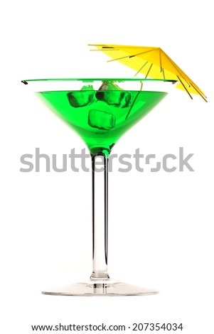 Martini glass with green coctail isolated on white - stock photo