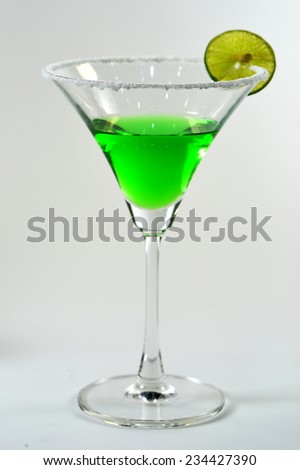 Martini glass with green coctail on white background  - stock photo