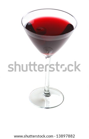 martini glass with red cocktail and cherry