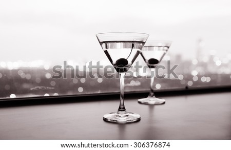 Martini glasses at a fine dinning restaurant in the city.  - stock photo
