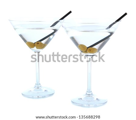 Martini glasses with olives isolated on white - stock photo