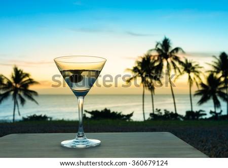 Martini in a beautiful beach setting.  - stock photo