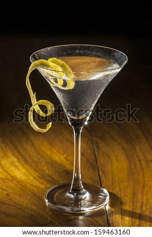 Martini with a lemon twist - stock photo