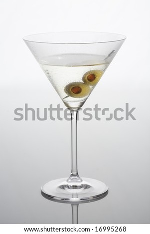 Martini with olives isolated on a light background