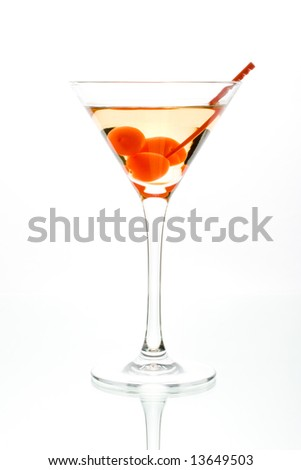 Martini with red cherry in a glass