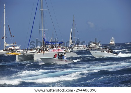 Martinique, Caribbean Sea � August .5. 2011 : spectators cheer Yoles Boat Race,  traditional regatta around the ocean in Martinique, using the vessels with rectangular sails, Martinique, Caribbean Sea - stock photo