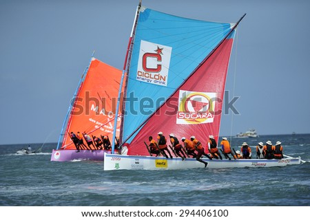 Martinique, Caribbean Sea - August .5. 2011 :  Yoles Boat Race, traditional sailing regatta around the ocean in Martinique, using the vessels with rectangular sails, Martinique, Caribbean Sea - stock photo