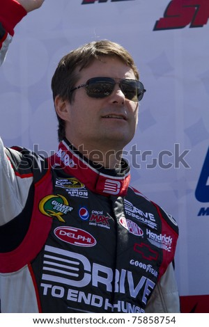 MARTINSVILLE, VIRGINIA - APRIL 3:  NASCAR driver Jeff Gordon acknowledges fans during driver introductions on April 3, 2011 at Martinsville Speedway, Martinsville, VA. Gordon finished fifth.