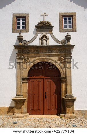 Marvao, Portalegre, Alentejo Region, Portugal. An ornate, baroque, arched church doorway and facade in the historic centre of  the hilltop frontier town. - stock photo