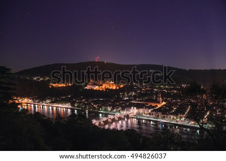 Marvellous night view with star sky over old bridge and castle in Heidelberg
