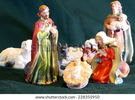 Mary and Joseph with the child Jesus in the manger with a shepherd - stock photo