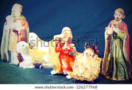 Mary and Joseph with the child Jesus in the manger with a shepherd and sheep - stock photo