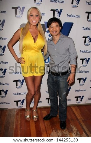 "Mary Carey and Dat Phan on the set of ""Politically Naughty with Mary Carey,"" TradioV Studios, Hollywood, CA 06-24-13"