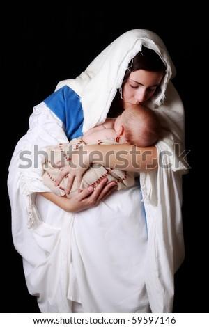 Mary kissing the baby Jesus - stock photo