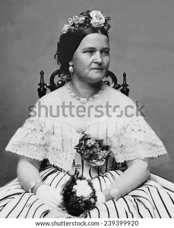 Mary Todd Lincoln (1818-1882), wife of Abraham Lincoln, in a ball gown and flowers in her hair. She was both admired and criticized for her stylish extravagance. - stock photo