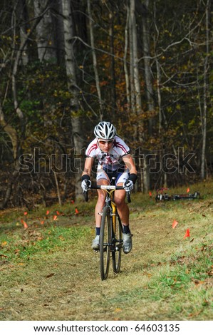 MARYLAND - NOVEMBER 7: A cyclist competes in the Tacchino Ciclocross competition on November 7, 2010 in Upper Marlboro, Maryland.