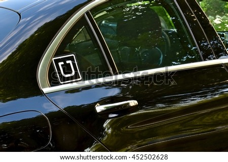MARYLAND, USA - JULY 12, 2016: A luxury Mercedes-Benz being used as an Uber transportation vehicle. Uber Technologies Inc. is an American multinational online transportation network company. - stock photo