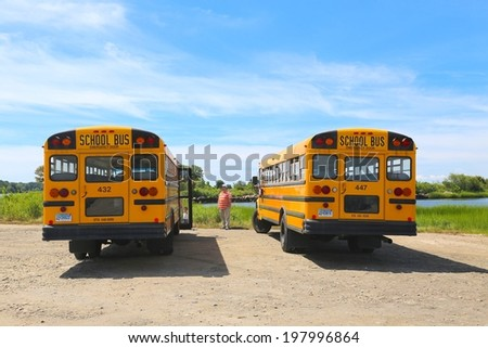 MARYLAND, USA - JUNE 08: Yellow School Buses in Maryland USA on June 08, 2014.  Maryland Department of Transportation provides safe, timely, and efficient transportation for all students. - stock photo