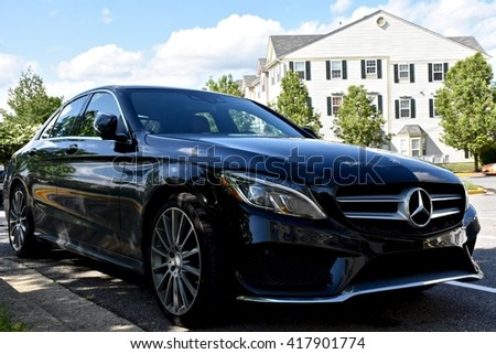 MARYLAND, USA - MAY 7, 2016: A black Mercedes Benz C400. Mercedes Benz is a luxury car dealer and manufacturer.