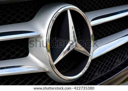 MARYLAND, USA - MAY 18, 2016: A Mercedes-Benz logo on a black C400. Mercedes-Benz is a luxury car dealer and manufacturer.