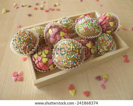 Marzipan sweets in wooden box - stock photo