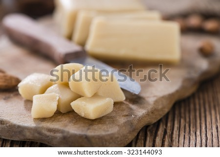 Marzipan with Almonds (close-up shot) on vintage wooden background