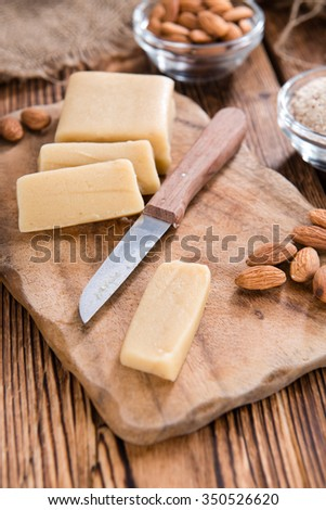 Marzipan with Almonds (close-up shot) on vintage wooden background - stock photo