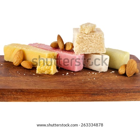 marzipan with almonds on wooden board close up isolated on white background - stock photo