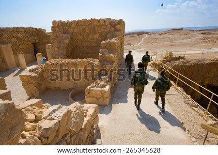 MASADA, ISRAEL - OCT 14, 2014: Soldiers are patrolling for security on masada in Israel - stock photo