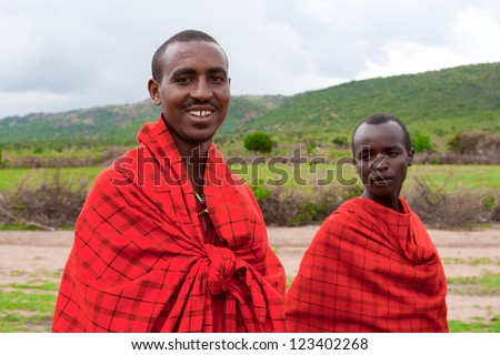 MASAI MARA, KENYA - DECEMBER 28: Two unidentified African men pose for a portrait on December 28, 2009 in Masai Mara, Kenya. Masai are a Nilotic ethnic group of people located in Kenya and Tanzania. - stock photo