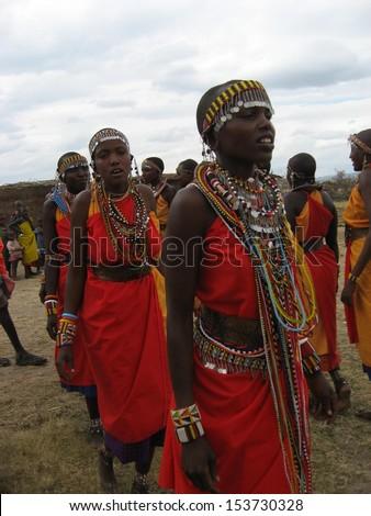 MASAI MARA, KENYA - JULY 16: Group of unidentified African women doing tribal dancing on July 16, 2010 in Masai Mara, Kenya. Maasai are a Nilotic ethnic group of semi-nomadic people located in Kenya. - stock photo