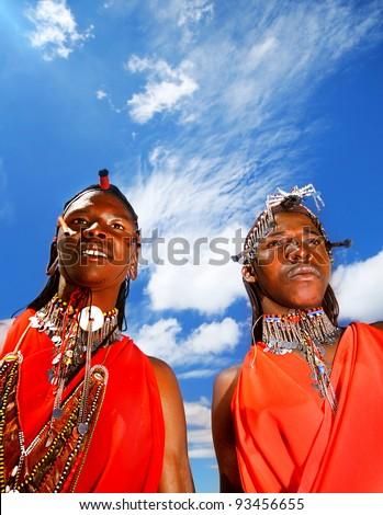MASAI MARA, KENYA - NOVEMBER 12: portrait of an African Masai men, warriors wear  cultural accessories for traditional dance on Nov 12, 2008 in tribal village,Masai Mara National Park Reserve, Kenya. - stock photo