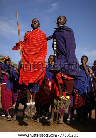 MASAI MARA,TANZANIA, AFRICA- MARCH 5: Masai warriors dancing traditional jumps as cultural ceremony, review of daily life of local people. Masai Mara National Park Reserve, March 05 , 2009, Tanzania