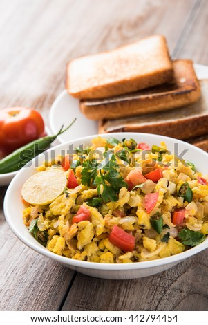 Masala Anda Bhurji of egg bhurji or Spicy scrambled eggs with bread slices or pav or paav and salad, tasty anda bhurji paav